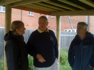 Marion Owen, John May and Cliff Marshall under the new shelter